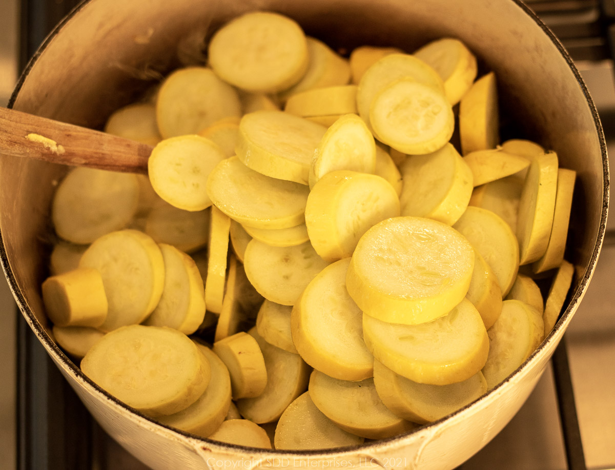 sliced yellow squash in a Dutch oven