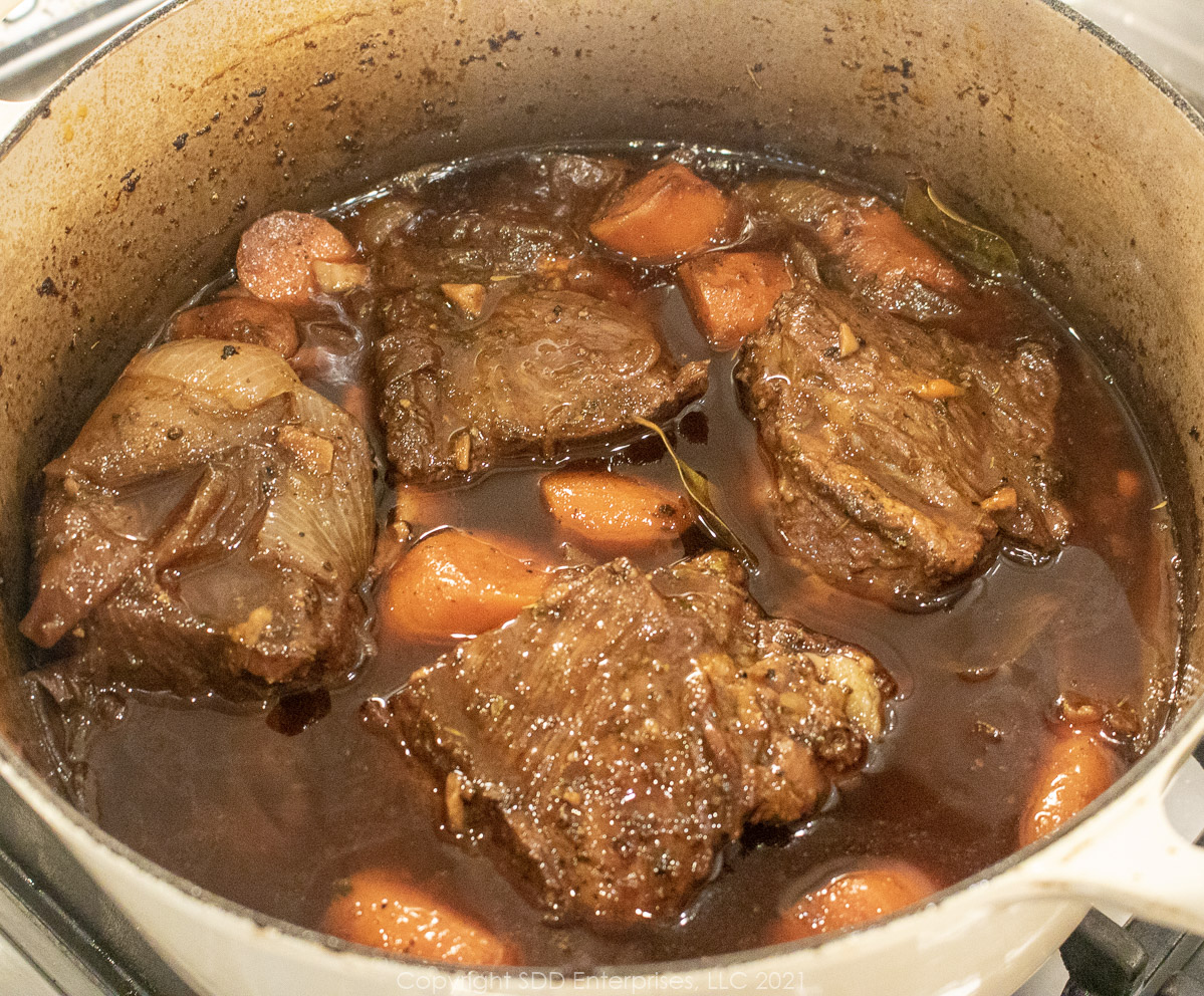 beef short ribs braising in in wine and stock