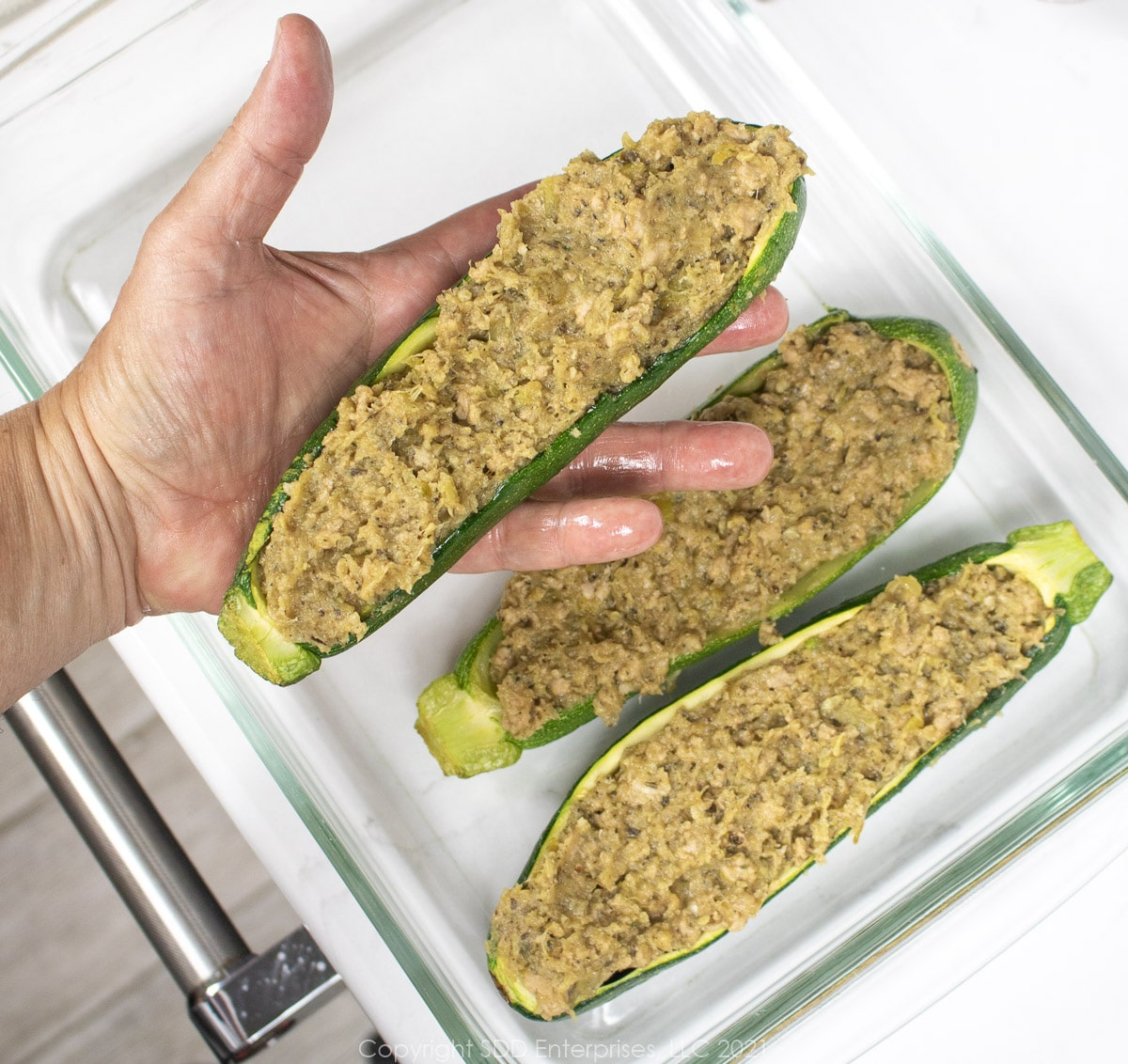 filling stuffed into hollowed zucchini and placed in a baking dish
