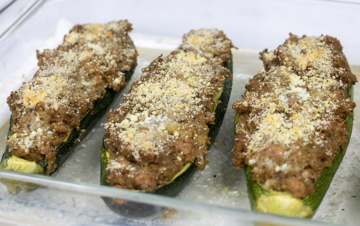baked stuffed zucchini in a baking dish
