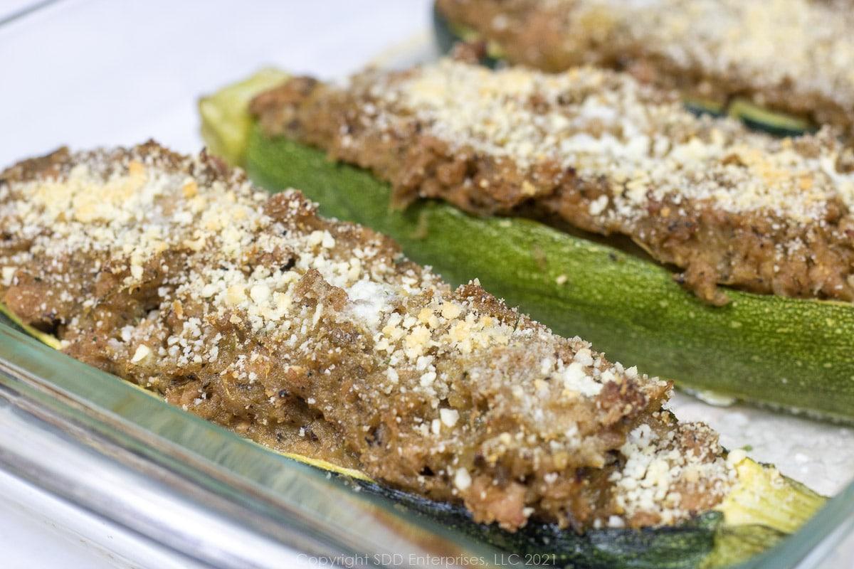 zucchini stuffed with pork on a baking dish
