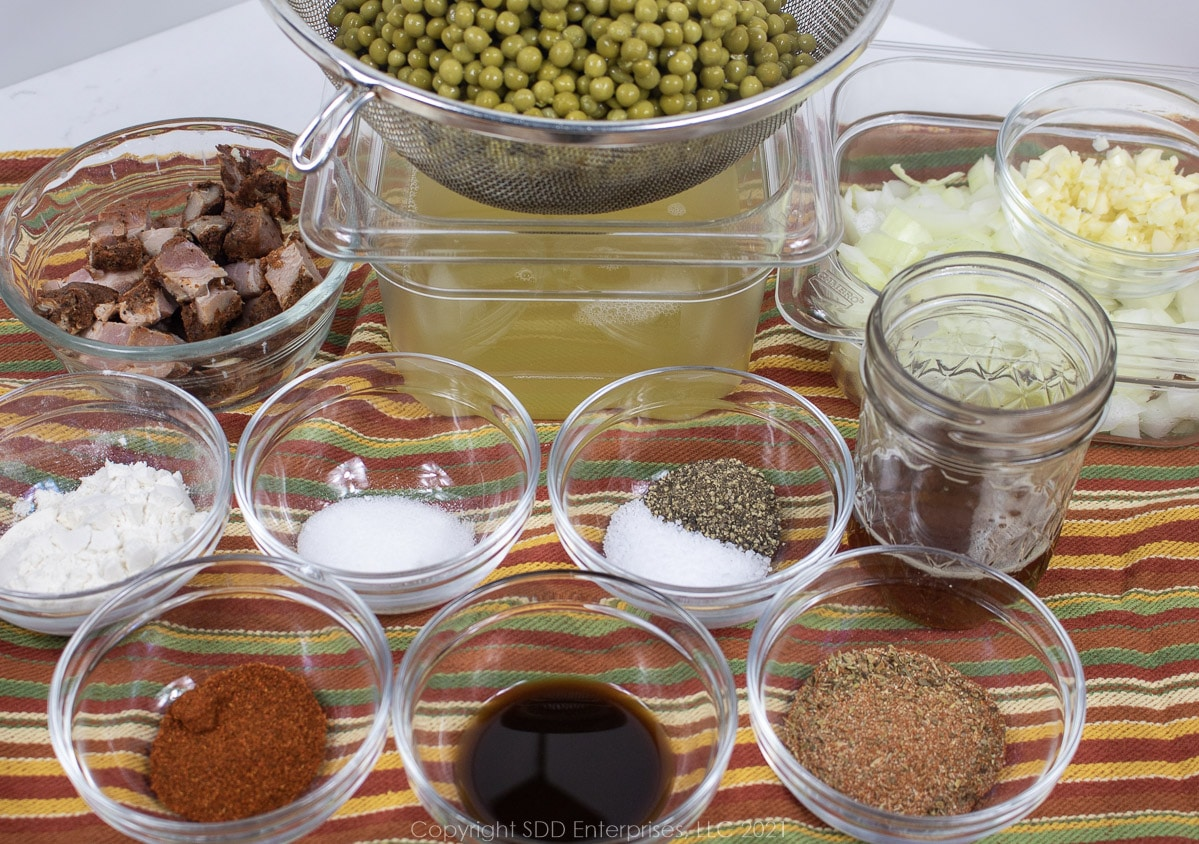 prepared ingredienst for peas in a roux laid out in prep bowls